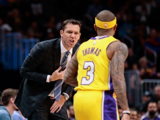 Los Angeles Lakers head coach Luke Walton yells to