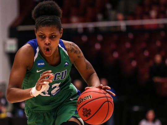 FGCU's Rosemarie Julien (32) dribbles the ball during