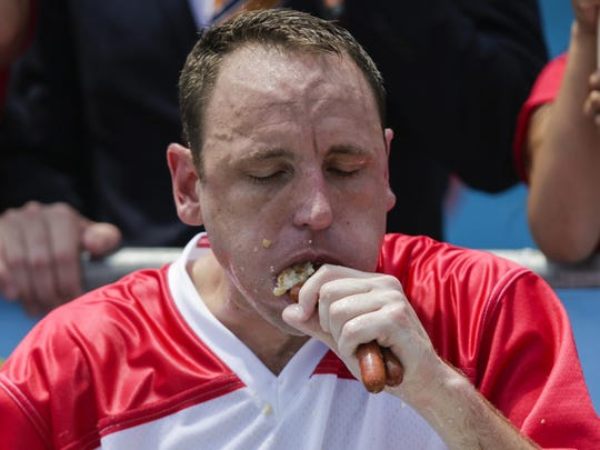 Joey Chestnut competes in the annual Nathan's Hot Dog Eating Contest in the Coney Island neighborhood of the Brooklyn borough of New York City. Chestnut won the contest, eating a Coney Island record 74 hot dogs in 10 minutes.