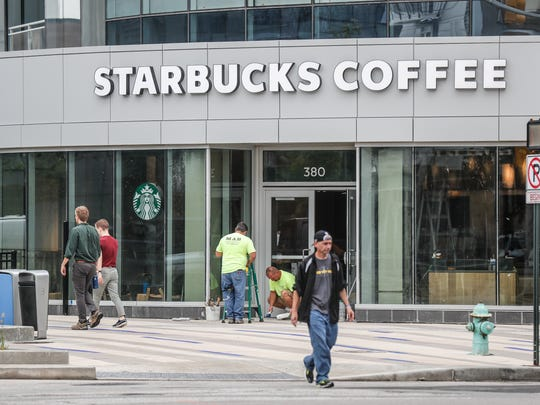Workers put finishing touches on a Starbucks at 360 Market Square, the site of the old Market Square Arena in downtown Indianapolis on Friday, Aug. 17, 2018.