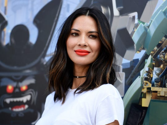 "In this July 21, 2017, file photo, actress Olivia Munn attends ""The Lego Ninjago Movie"" photo op at Comic-Con International in San Diego. Munn and five other women have accused film director Brett Ratner of sexual harassment or misconduct in a Los Angeles Times report."