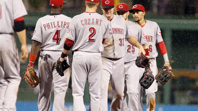 The Cincinnati Reds celebrate after defeating the Pittsburgh Pirates 11-4 at PNC Park on Wednesday.