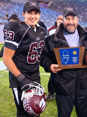 Mike Zaccone Jr. celebrates Wayne Hills' title with his father, Mike Zaccone Sr., last December.