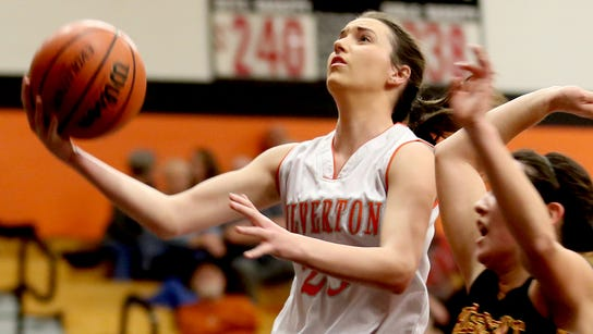 Silverton's Alia Parsons (23) goes for two points while
