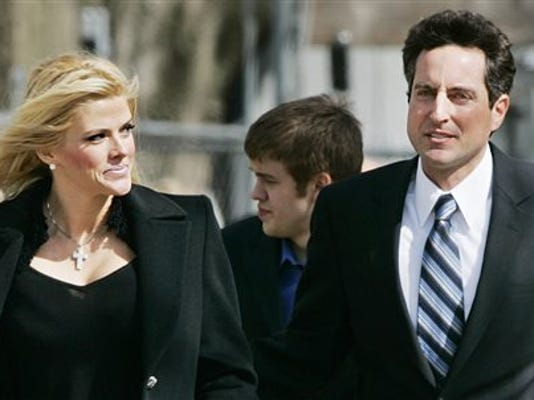 FILE - In this Feb. 28, 2006 file photo, Anna Nicole Smith, left, and her lawyer, Howard K. Stern leave the U.S. Supreme Court in Washington.