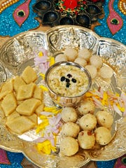 This platter of sweets for Diwali includes rava ladoo
