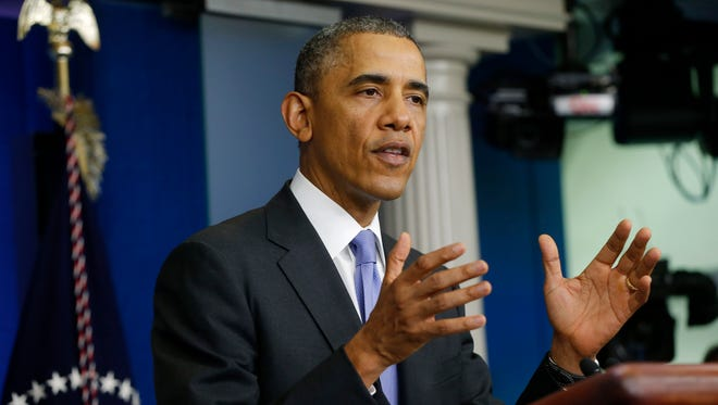 President Barack Obama speaks to reporters in the Brady Press Briefing Room of the White House in Washington on May 21, 2014.