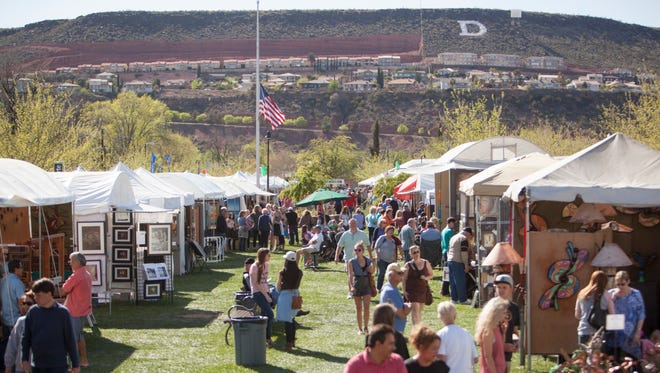 Artists display their work at the 37th annual St. George Art Festival Friday, March 25, 2016.