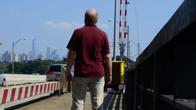 Record reporter Jim Beckerman crosses the Hackensack River bridge on Routes 1 & 9, retracing the steps he took on Sept. 11, 2001, when he walked nearly 7 miles from Newark to Liberty State Park in Jersey City.
