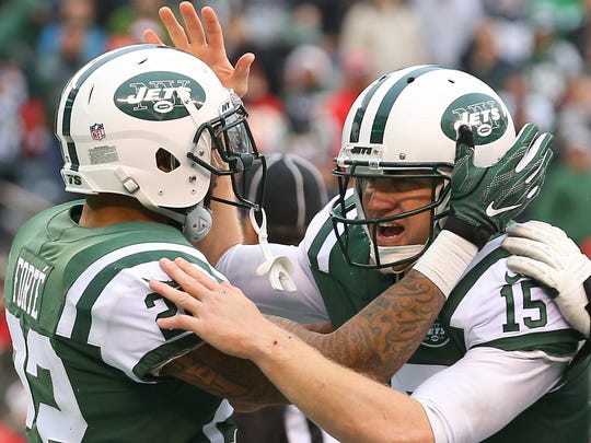 New York Jets running back Matt Forte and quarterback Josh McCown celebrate their touchdown during the first half of their game against the Kansas City Chiefs at MetLife Stadium.