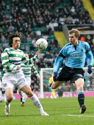 Australia's Karl Dodd (right, in blue), playing at the time for Falkirk FC, plays the ball away from Celtic's Shunsuke Nakamura of Japan on Dec. 23, 2006 in front of a crowd of 55,000 at Celtic Park in a Scottish Premier League match. Dodd has been appointed as the new Head Coach of the Matao, Guam men's national team beginning Jan. 18. Photo courtesy of Karl Dodd.