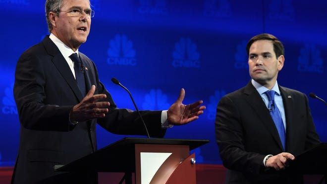 Republican Presidential hopeful Jeb Bush speaks as Marco Rubio looks on during the CNBC Republican Presidential Debate, October 28, 2015 at the Coors Event Center at the University of Colorado in Boulder, Colorado.