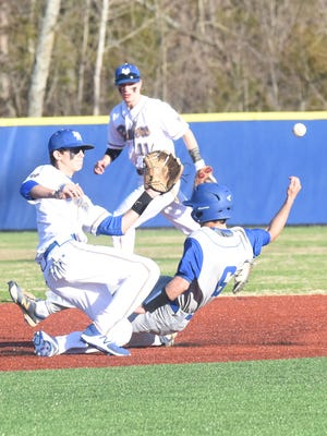 Mountain Home shortstop Josh Prinner attempts to tag Harrison's Thailer Lovell during the Bombers' 7-3 victory on Monday at Pitts Field.