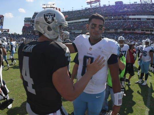 Raiders QB Derek Carr and Marcus Mariota shake hands after their game at Nissan Stadium. The Raiders won 17-10.