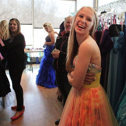 Kylie Roepcke, 17, (right) of Collins, Wis., has a laugh with volunteers as she works with Melissa Linden, her Fairy Godmother to pick out a prom dress as Operation Cinderella takes place at the Warch Center on the Lawrence University campus in Appleton, Wis., on Saturday, March 28, 2015. Fairy Godmothers work with each girl to get them ready for the coming prom season. Operation Cinderella finds participants through guidance counselors at 16 area schools. Ron Page/Post-Crescent Media