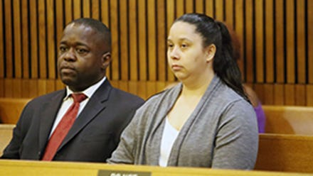 Charlie Bothuell IV, left, and his wife Monique Dillard-Bothuell, are shown in court July 11, 2014, during a probation hearing in an unrelated matter. Bothuell's son was found in the basement of their Detroit home after he was missing for 10 days.