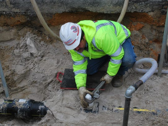 Carlos Rojas, a New Jersey Natural Gas foreman, works on Long Beach Island in this file photo.