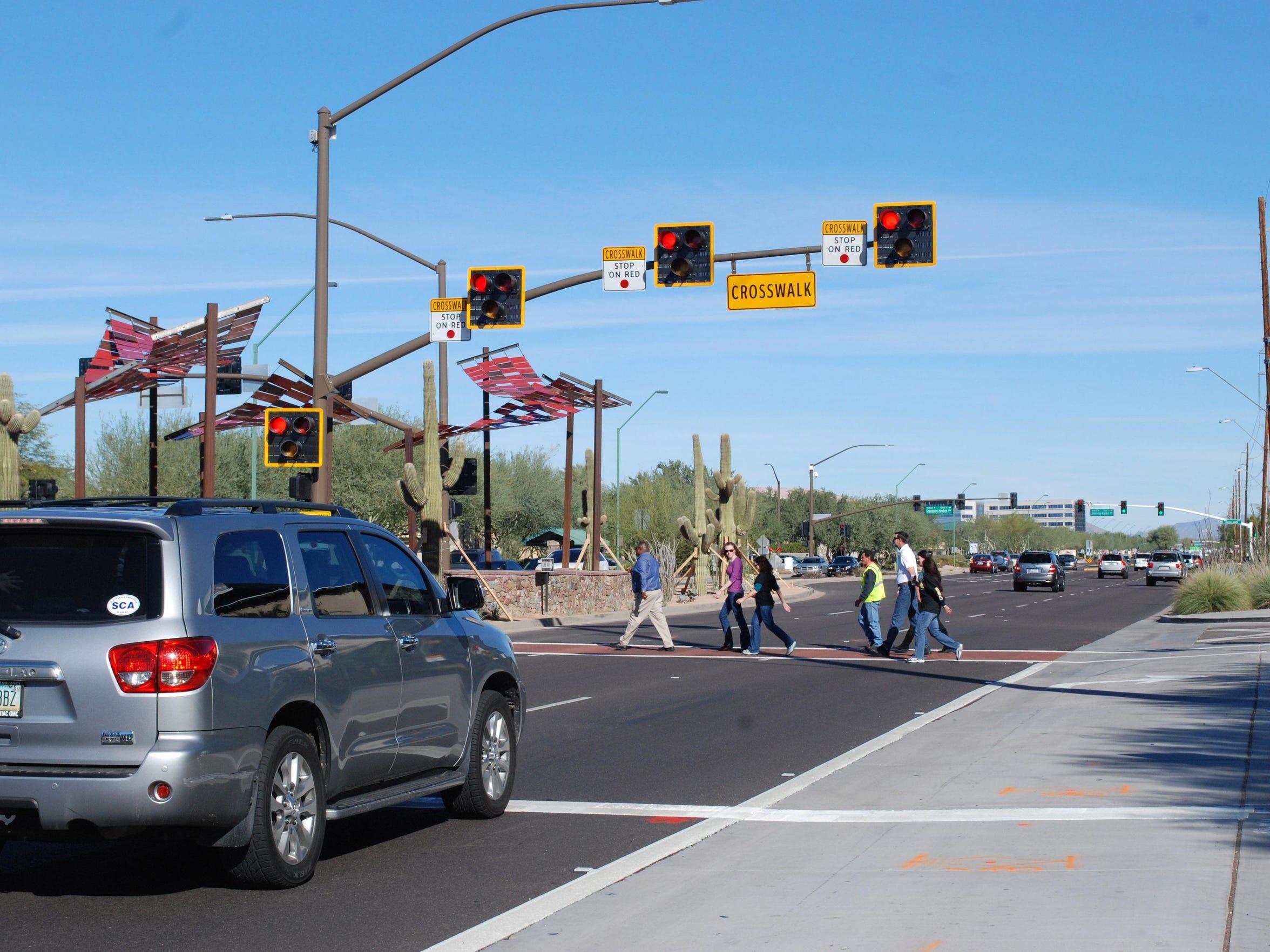 Scottsdale Road Pedestrian Hybrid Beacon with pedestrians in the crosswalk (