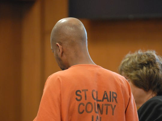 Aaron Lemont Swift stands beside his lawyer, Sharon Parrish, Tuesday, July 7, 2015, in District Judge John Monaghan's courtroom. Swift, 41, is charged in the death of 45-year-old Regina Renee Reyna.