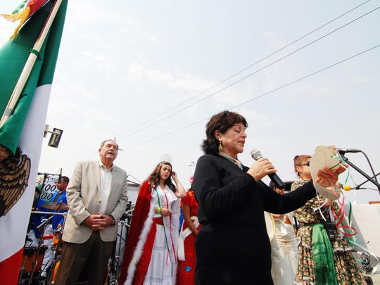 Blanca Zarazua, Honorary Consul for Mexico in Salinas, leads the traditional 2:00 PM ceremony reenacting the country's cry for independence from Spain.