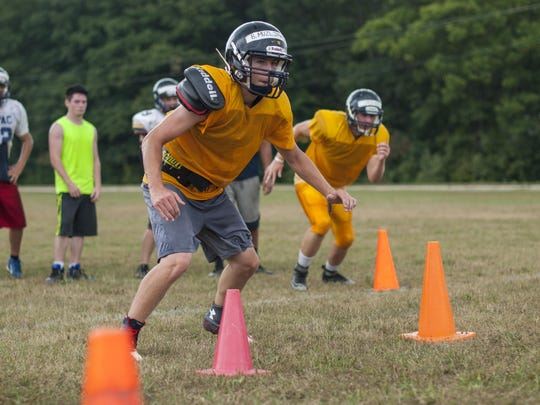 Brandon Muzljakovich runs through some cones Thursday, Aug 11, during football practice at Capac High School.