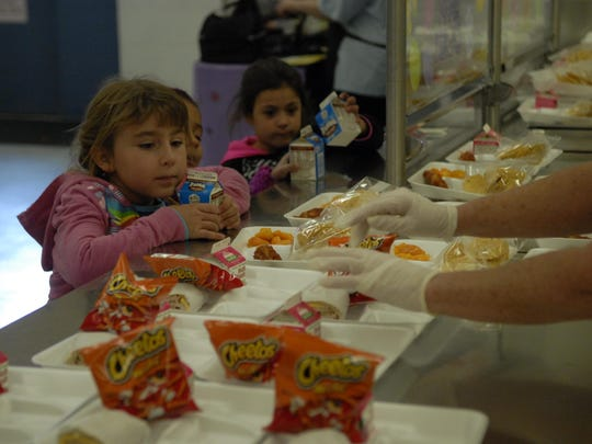 Students ponder what to eat with offerings of enchiladas or wraps and Cheetos Friday at Fernley Elementary School.