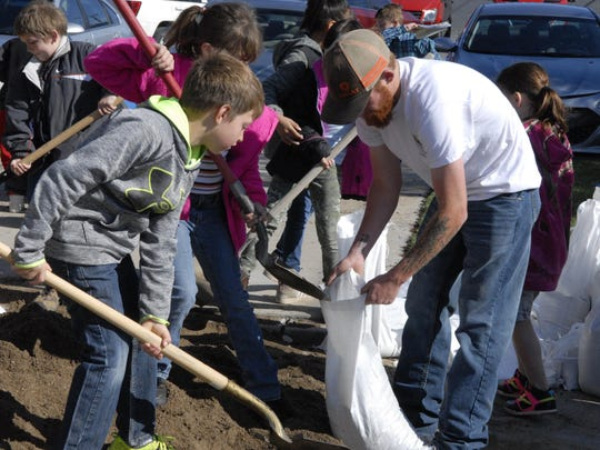 Yerington Elementary School students and a group of volunteers fill sandbags in April at the Mason Valley Fire Protection District's station on Main Street.