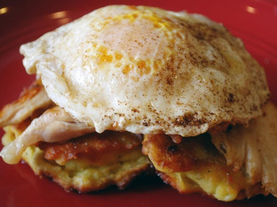 Classic eggs Benedict are refashioned with leftover Thanksgiving mashed potatoes (instead of English muffins), turkey (for Canadian bacon), and gravy (in place of hollandaise).