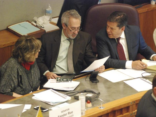Feb. 2020 file photo of three sponsors of red flag gun legislation – Sen. Joseph Cervantes, D-Las Cruces, right, and Reps. Daymon Ely, center, D-Corrales, and Joy Garratt, left, D-Albuquerque – who conferred during the New Mexico Senate floor debate on Feb. 7. Associated Press.