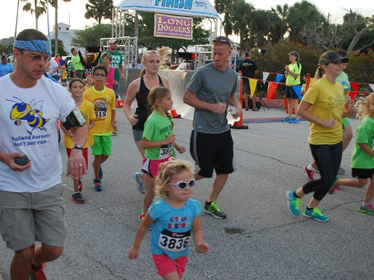 Runners participate in the Long Dogger's Kids Marathon and Half Marathon at Ryckham Park in Melbourne Beach in 2019. Proceeds from the race benefited the Morning Mile Program.