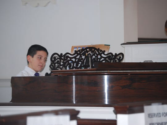 Jackson Feiner, 11, of Alexandria Township performs at his first piano recital. The Alexandria Middle School sixth-grader is a student at The Hunterdon Academy of the Arts, located in Flemington, where he is instructed by piano teacher Drew Spradlin. Feiner performed Planetarium and Minuet during the recital, which was conducted at the Stanton Reformed Church in Lebanon.