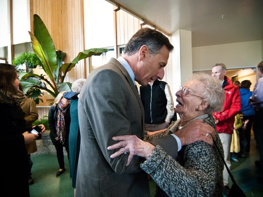 Gov. Peter Shumlin hugs Lola Aiken, wife of former governor and U.S. senator from Vermont George D. Aiken. The University of Vermont's George D. Aiken Center officially opened in 2012.