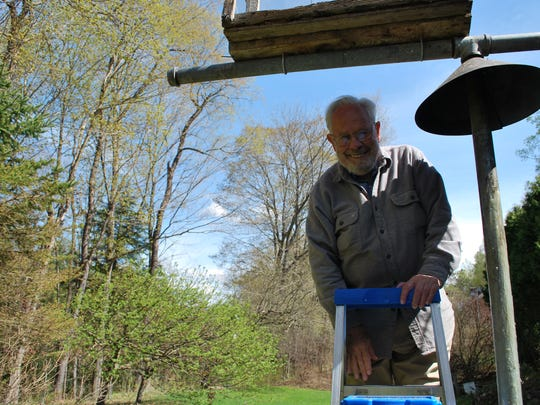 The late Bob Spear, photographed in April, 2010, fills a bird feeder at the Birds of Vermont Museum in Huntington.