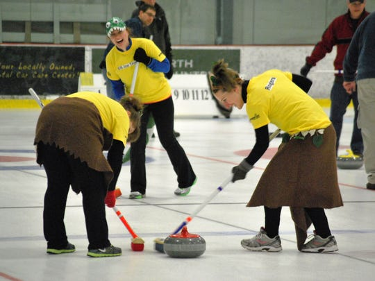 First-time curlers Mariya Zak of St. Albans (from left), Elena McCormick of Williston, and Meagan Rogers of Underhill participated in the HowardCenter Curling for Kids Fundraising Tournament at Cairns Arena in South Burlington on March 15, 2014.
