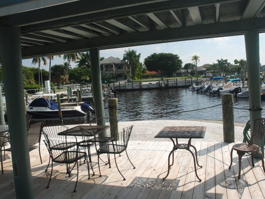 A shaded patio along the marina offers residents a place to socialize by the water.