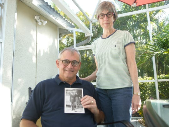 Keith and Ruth Dalen, of Estero, with a photo of his grandfather and mother, Raymond and Angelica Ferrer.