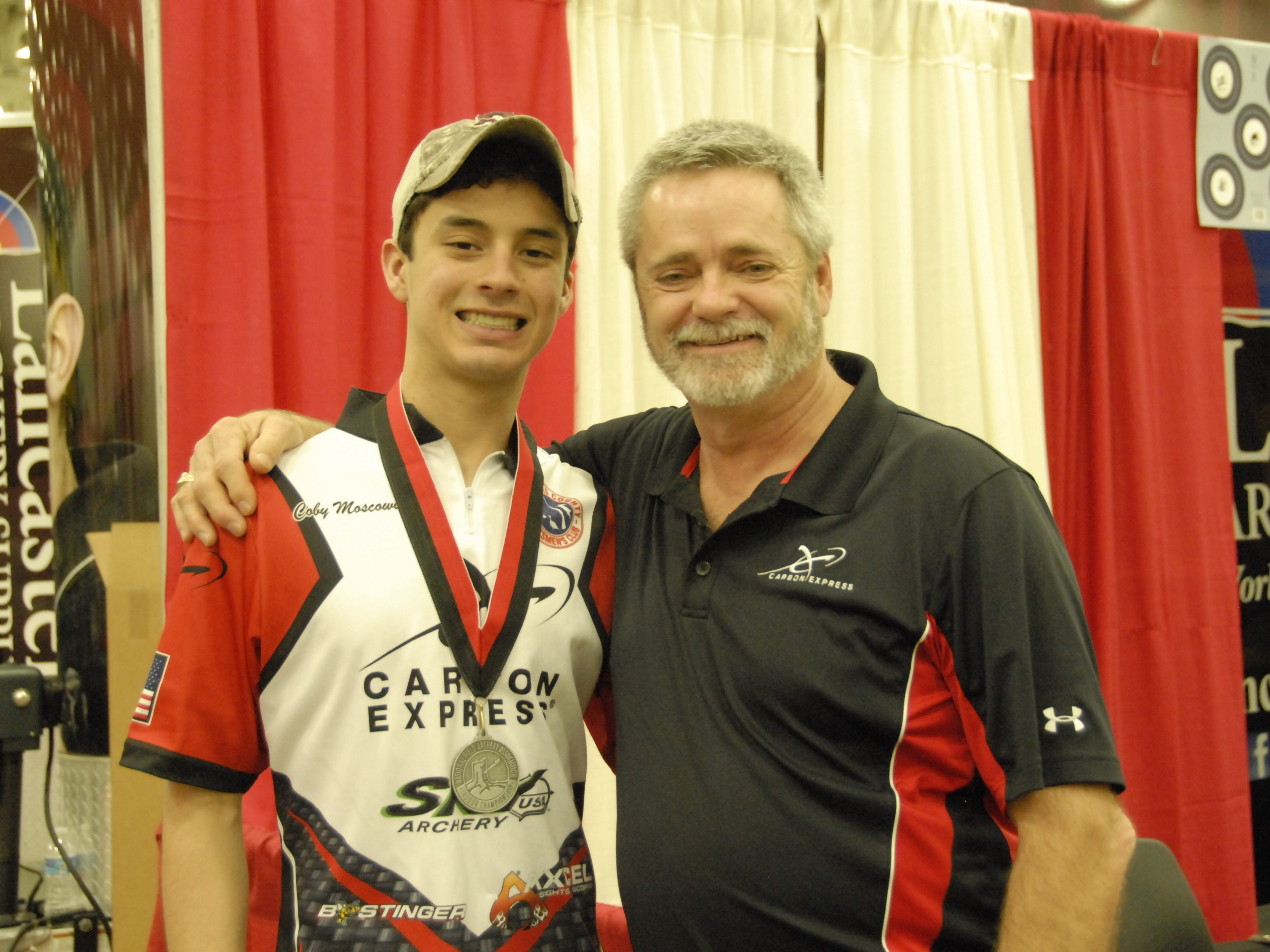 Seaholm High School student Coby Moscowitz is pictured with his archery coach Jim Morrow.