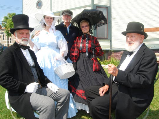 Carl. A. Moss, left, Trish Moss and Rock Stevens, all of Port Huron, and Joanne and Claude Lawrence of Marysville prepare for the Fenian Day celebration at the Atrium Cafe in Port Huron.