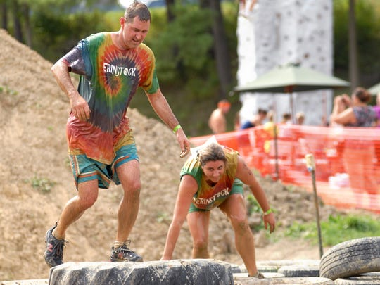 Kim and Brian Nikesch race through the obstacles at the SwampFoot 4 Mile race in St. Clair Township.