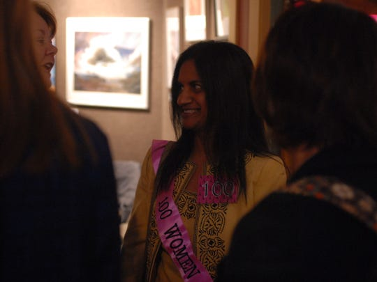 Sushma Reddy, board member for the Community Foundation of St. Clair County, talks with others during the fourth annual 100 Women Who Care event Thursday at the Port Huron Musuem.