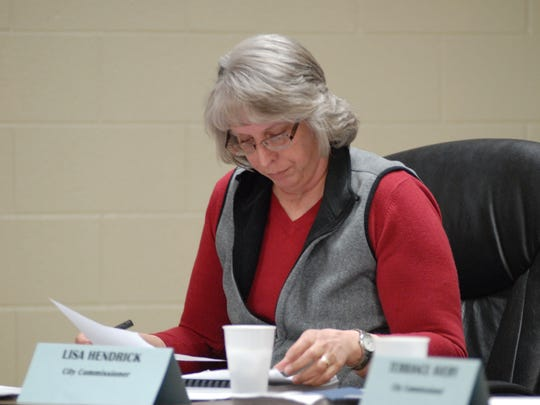 Commissioner Lisa Hendrick looks through her notes Tuesday during a Marine City Commission budget meeting at the fire hall. The commission is considering a special assessment tax and raising water/sewer rates.