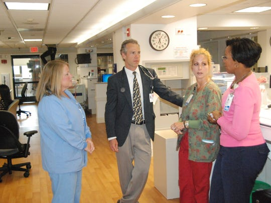 Palliative care nurses at Salinas Valley Memorial Hospital ask questions of Dr. Matthew Katics, who heads up the SVMH palliative medicine team.