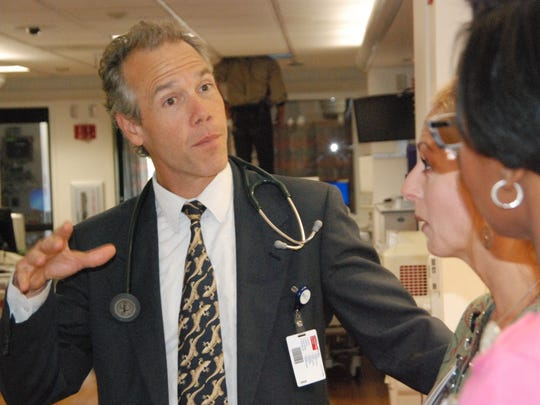 Dr. Matthew Katics explains directions to palliative care nurses Thursday at Salinas Valley Memorial Hospital.