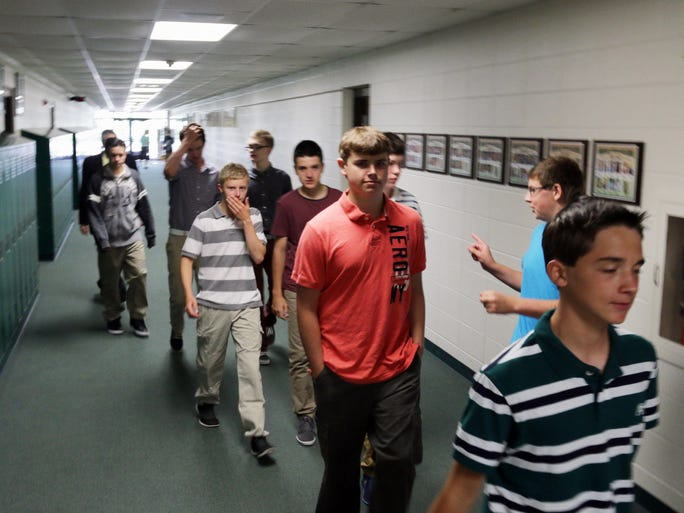 Sheboygan Lutheran students walk to the start of the school year assembly Wednesday August 20, 2014 in Sheboygan.