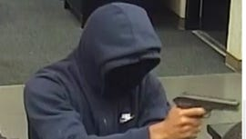 A suspect in the armed robbery of the US Bank branch at 3168 Harrison Avenue.