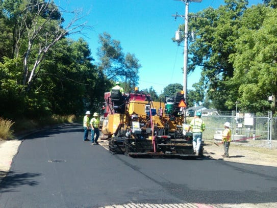 Workers pave the intersection on Wednesday afternoon.