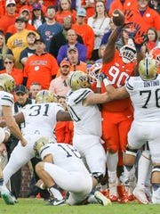 Clemson defensive lineman Dexter Lawrence (90) blocks an extra point attempt by Pitt kicker Chris Blewitt during the second quarter on Saturday at Memorial Stadium in Clemson.