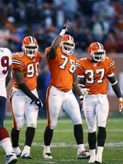 Defensive ends Mark Word #90, Tyrone Rogers #78 and