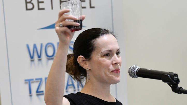 Cantor Rachel Gottlieb Kalmowitz raises her cup of