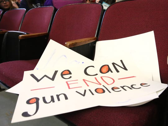A student's sign for the walk-in assembly for gun violence at Wappingers Junior High on March 14, 2018.